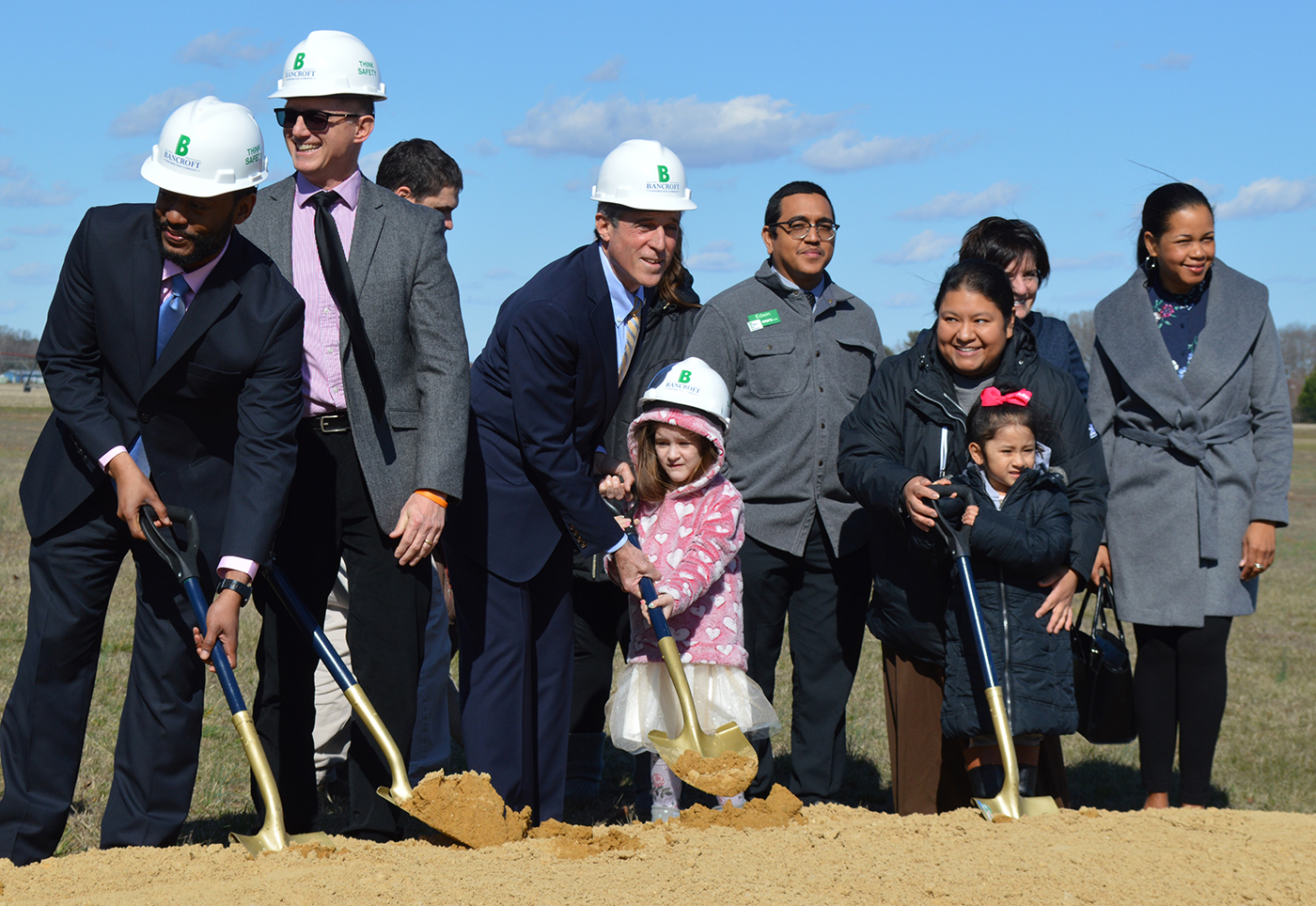 Governor John Carney, Board members and families shovel dirt during ground breaking ceremony.